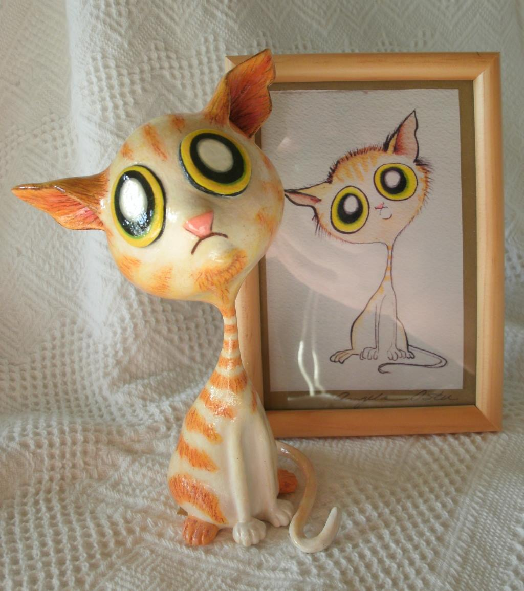 A 3d model of a cartoon cat sitting in front of a matching illustration