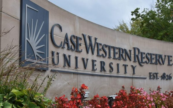 Case Western Reserve University sign with flowers