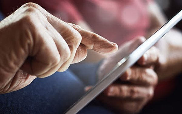 Image of senior citizen using tablet