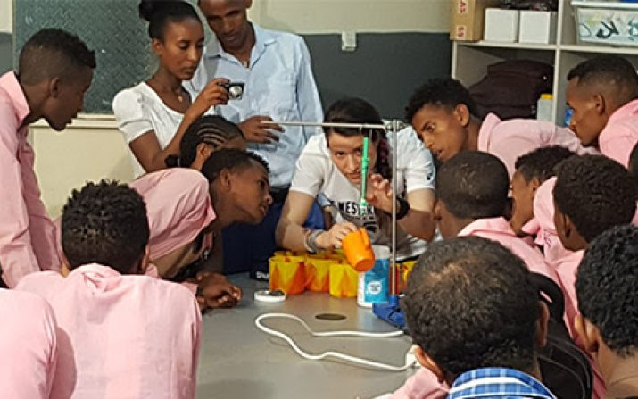 Students participating in an engineering demonstration
