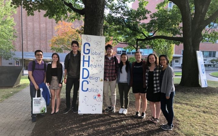Group shot of pulse ox team holding a GHDC sign