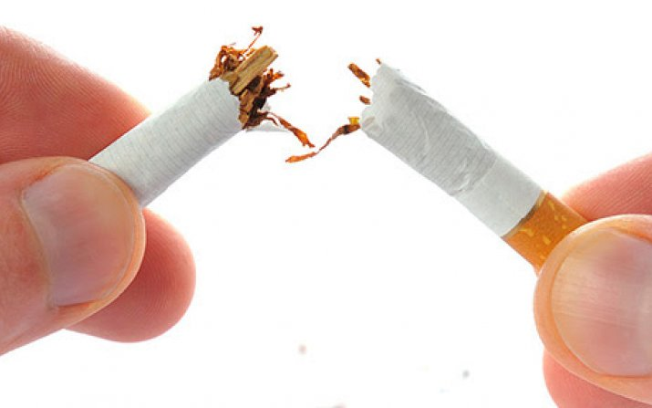 Photo of someone breaking a cigarette in half