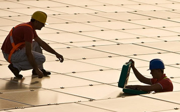 Photo of utility workers working with solar panels