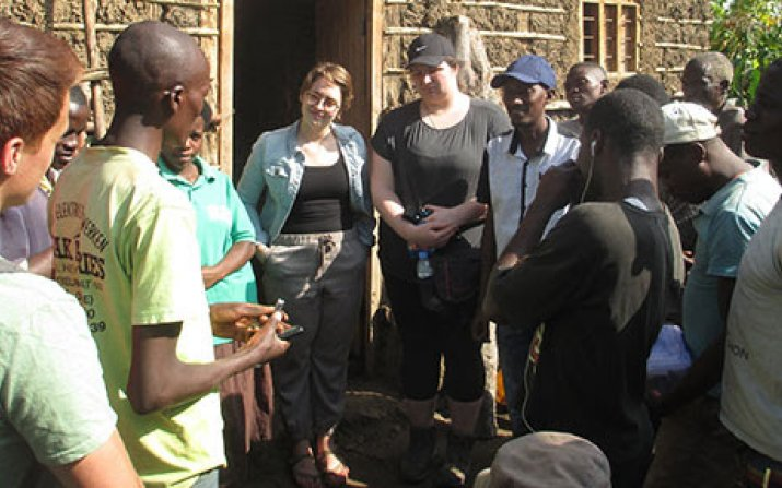 Engineering students meeting with Rwandan villagers