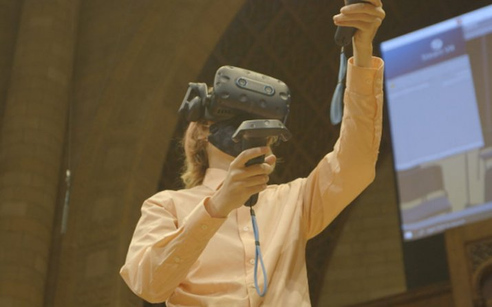 Person controlling a VR system with remote controls