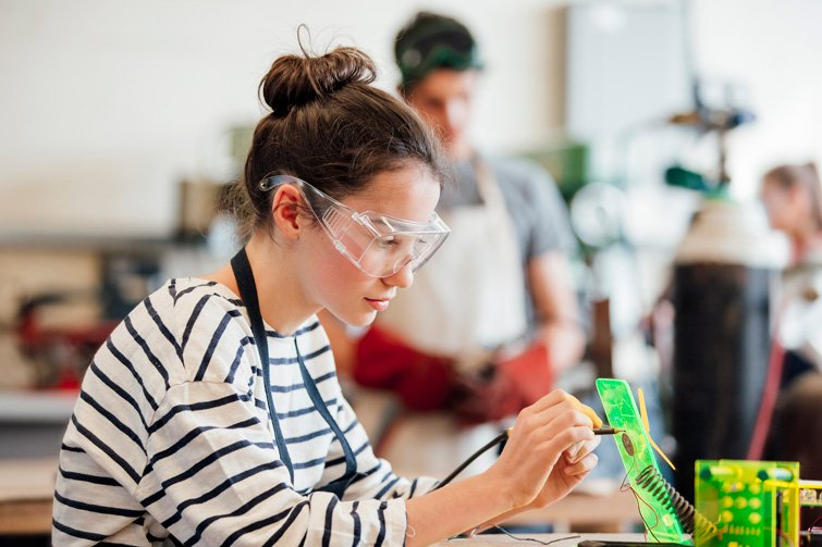 Female engineering student working in a lab