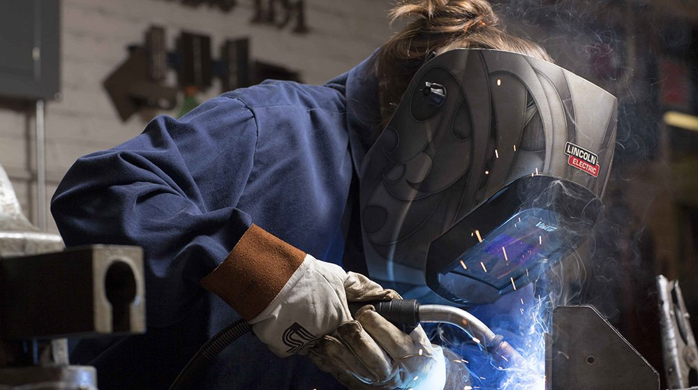 female mechanical and engineering student welding