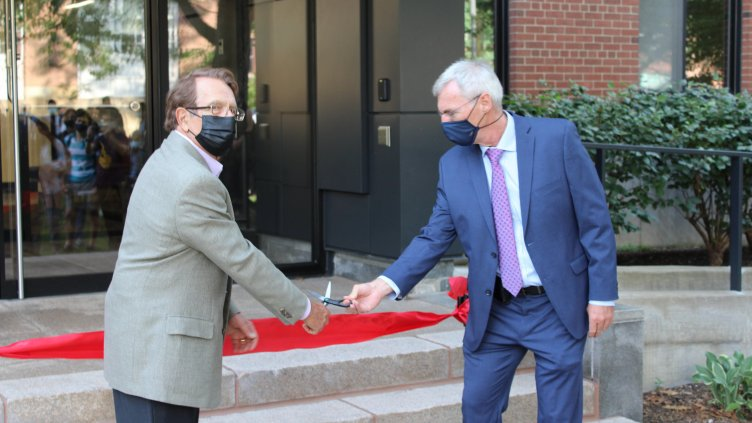 Robert Smialek and Frank Ernst cut the ribbon to reopen White Building
