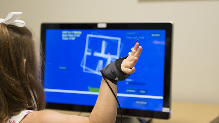 Patient using hand therapy video game