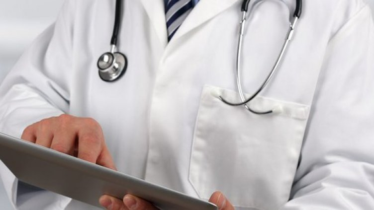 Doctor in white coat with stethoscope