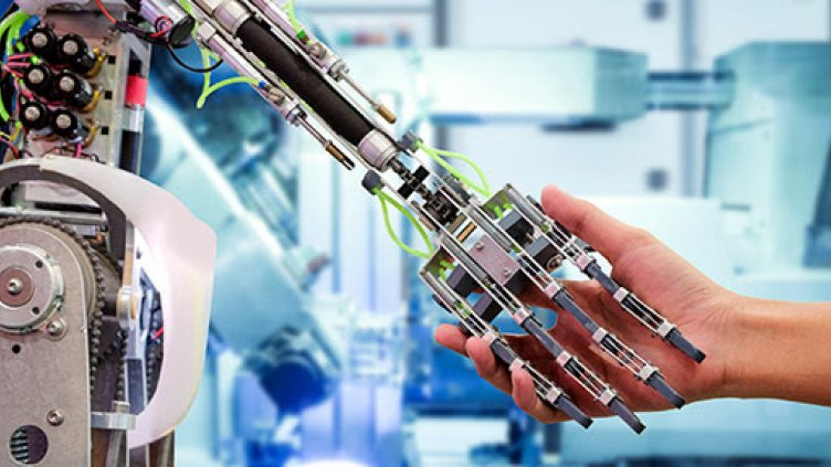 Image of robotic hand and human hand