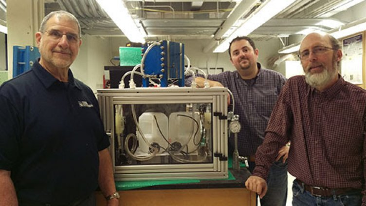 Bob Savinell, Nick Sinclair and Jesse Wainright with a 100-watt model of their iron-flow battery