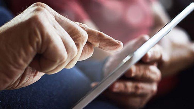 Image of senior citizen using tablet