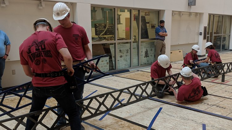 CWRU students working on the steel bridge