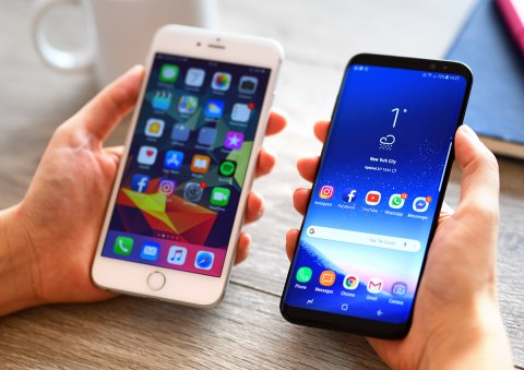 two smartphones held side by side