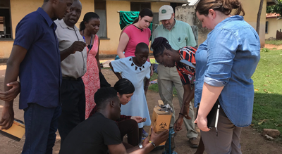 CWRU students and faculty demonstrating a device in Uganda