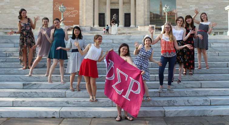students of Phi Sigma Rho on steps of art museum