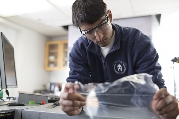 Student researcher working with plastic film