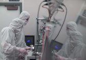 researchers in clean room