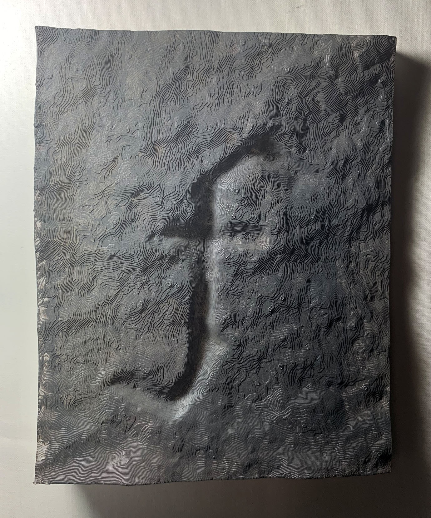 A 3D printed block of a rocky surface with a rendering of the letter 'F' in a graffiti font.